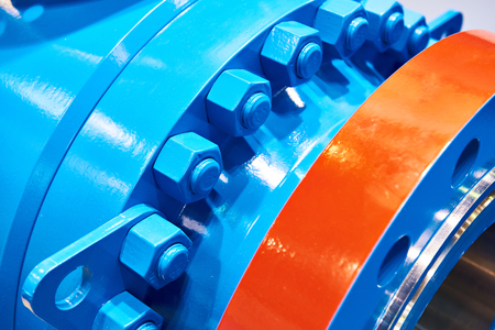 Blue bolt nuts on industrial equipment