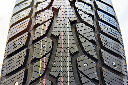 Winter stud tire for cars closeup