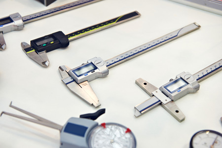 Digital calipers on white background in store