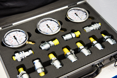 Set of pressure gauges and valves in box