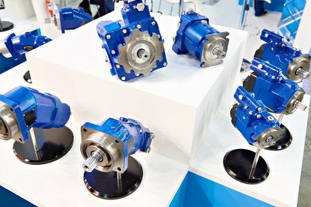 Axial piston pumps and hydraulic motors on showcase of store Фото со стока