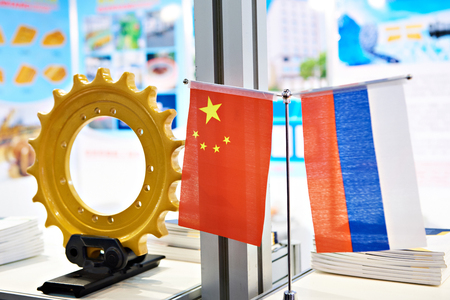 Flags of Russia and China. Business industrial cooperation Фото со стока