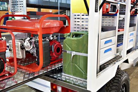 Gasoline generator and canister with fuel in car support