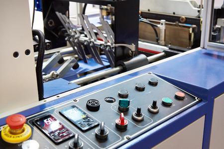 Control panel of plastic bag making machine on plant Stock Photo