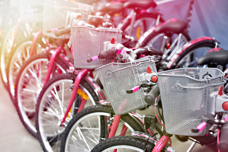 Row of new bicycles with shopping baskets in sport store Фото со стока