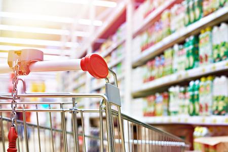 Shopping cart in store shelves