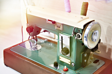 Old sewing machine on the table