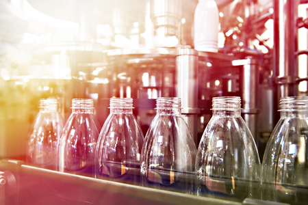 Line of bottling beverages in plastic bottles on factory