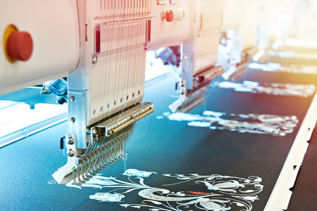 Embroidery industrial machine in sewing workshop Фото со стока