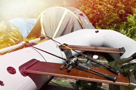 Spinning rods for fishing on inflatable rubber boat
