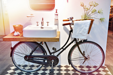 Washbasin and retro bicycle in the bathroom