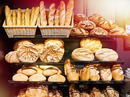 Fresh bread on shelves in a bakery Фото со стока