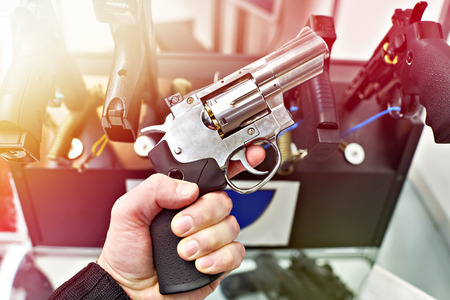 Revolver Dan Wesson in the hand of the buyer in the arms store