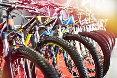 Row modern mountain bikes in sports shop