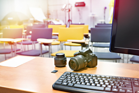 Place the teacher in photography school classroom and photo camera