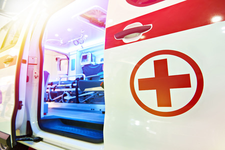 Opened door of ambulance with medical equipment