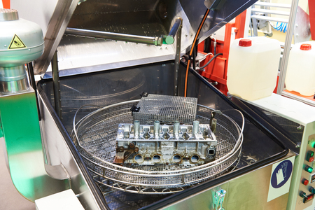 Automatic washing system for engine parts and assemblies