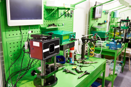 Workplace for the control of fuel injectors Фото со стока