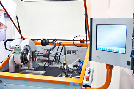 Machine for balancing the shaft of the turbocharger with monitor Фото со стока