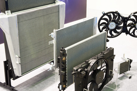Radiators and fans of cooling systems of a truck in the shop