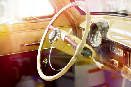 Steering wheel and interior of a retro car Фото со стока