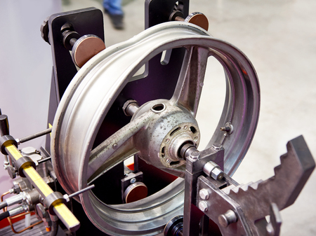 Stand for straightening disk wheel Фото со стока