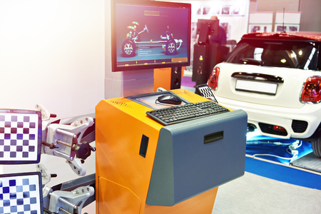 Wheel alignment stand with infrared communication