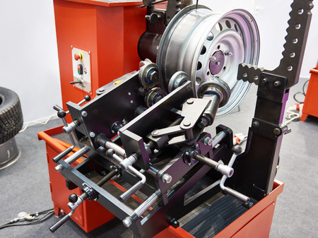 Stand for straightening stamped disk wheel Фото со стока