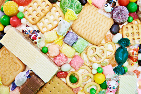 Candy and cookies as background