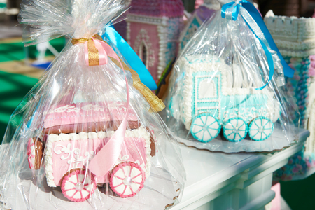 Toy blue locomotive and pink wagon of gingerbread Фото со стока