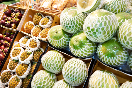 Fruits of pomelo and pineapple on the market counter
