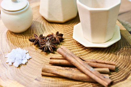 Still life with tea, cinnamon and cloves on wooden