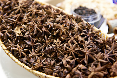 Star anise in wooden plate
