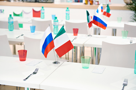 Russian italian flags at business meeting