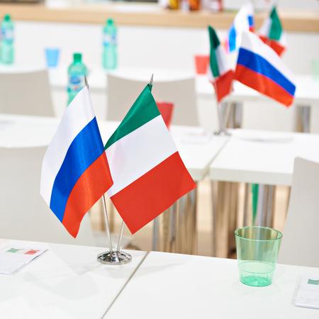 Russian italian flags at a business meeting Фото со стока