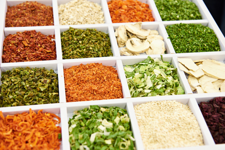 Dried seasoning vegetables and mushrooms on the counter of store