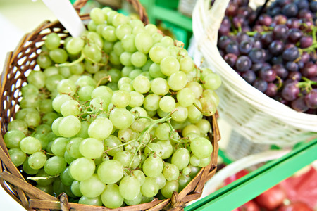White and red grapes closeup in store