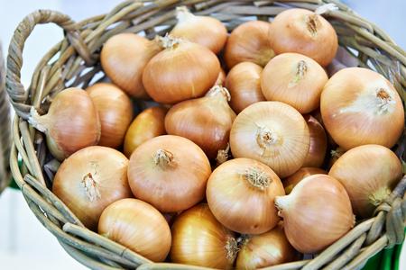 White onions in a wicker basket