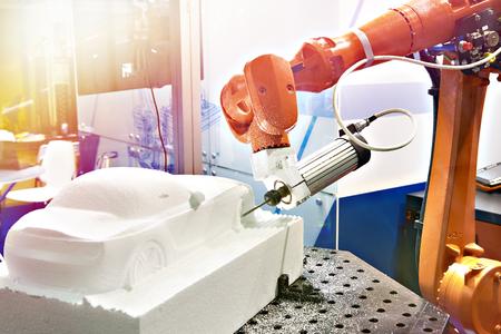Industrial manipulator for making a plastic car model