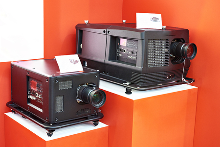 Lamp and laser phosphor projectors in store at exhibition
