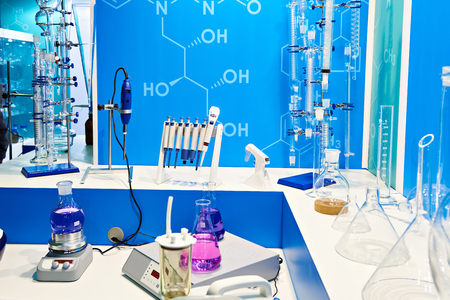 Chemical flasks with liquids and equipment in lab