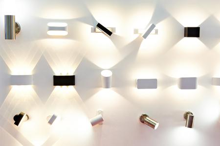 Modern wall lights in the store Фото со стока