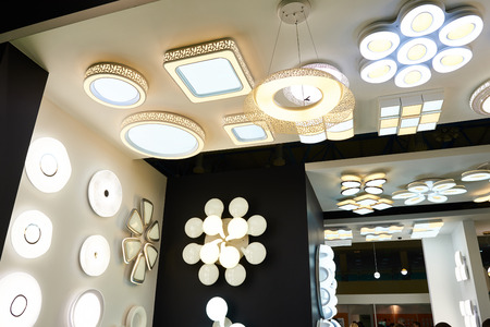 Decorative ceiling lamps and chandeliers in the store Фото со стока