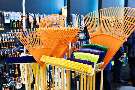 Rake for removing leaves and sweeping brushes in the store