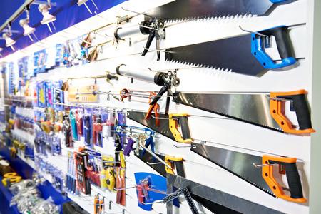 Hand saws in a construction tool shop Фото со стока
