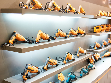 Drills on shelves in hardware store