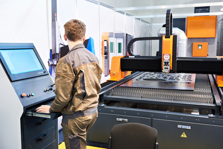 Worker operator laser cutting complex for metal