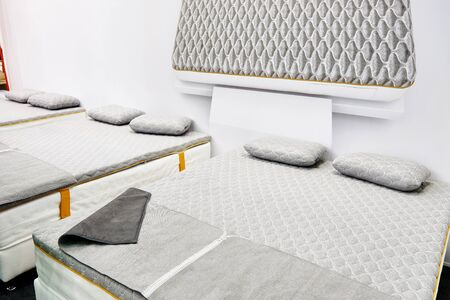 Gray mattress on a double bed in store Banco de Imagens