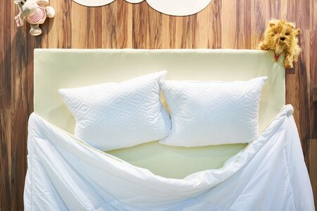 Pillows and blanket on the bed