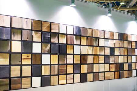 Samples of wood panels for furniture on stand store Banco de Imagens